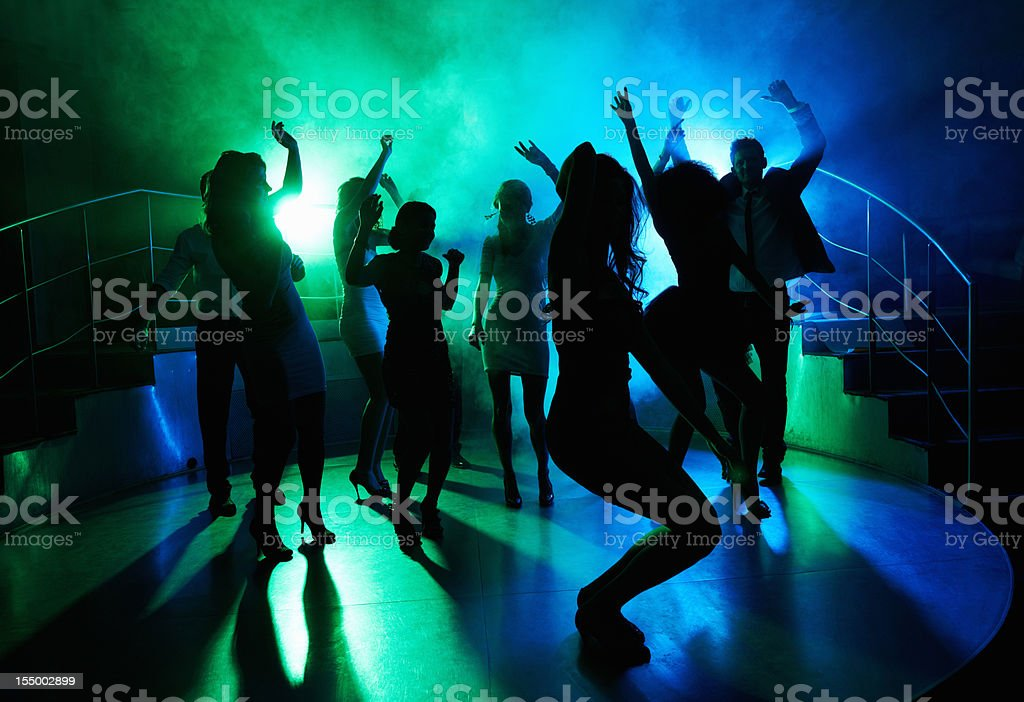 People having fun on dance floor at a night club stock photo