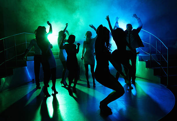 people having fun on dance floor at a night club - dance floor stock photos and pictures
