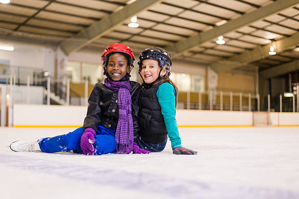 People having fun on skating rink stock photo