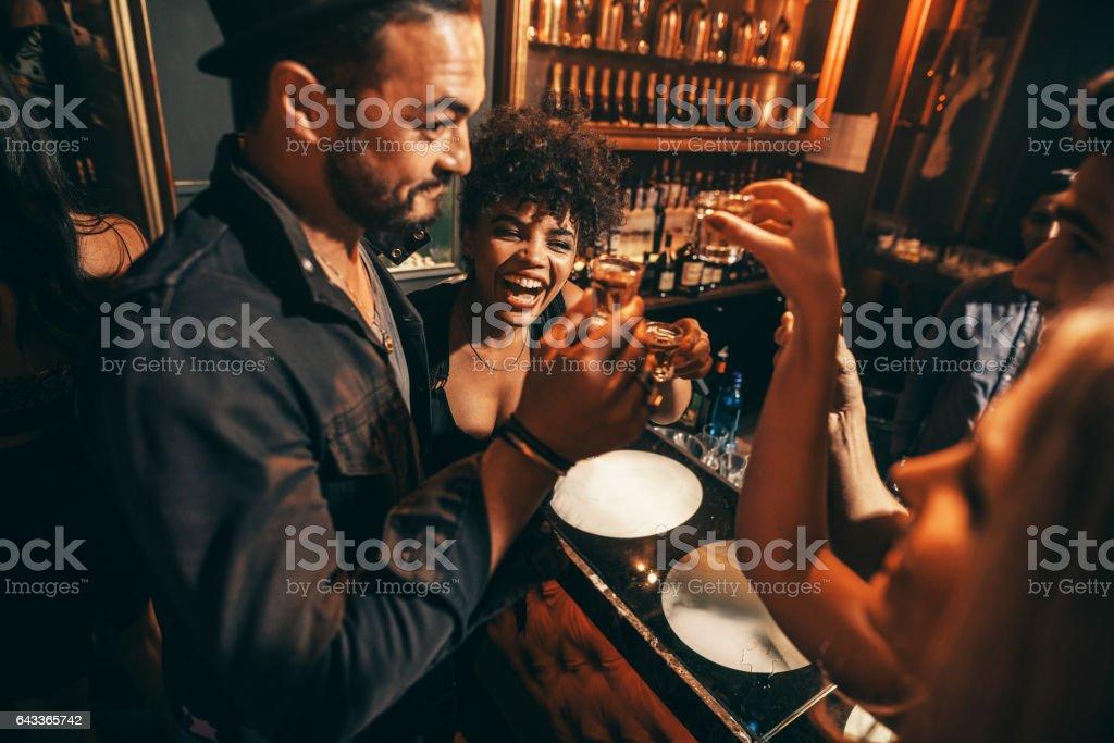 People having fun with drinks at nightclub stock photo