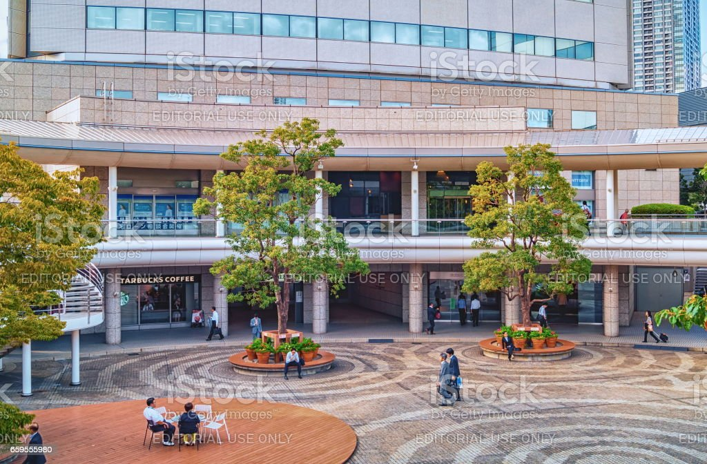 People having rest in the inner courtyard of the typical living node building in Tokyo, Japan stock photo