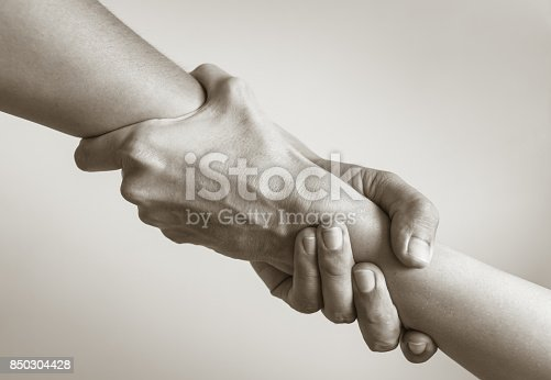 istock People helping each other. 850304428