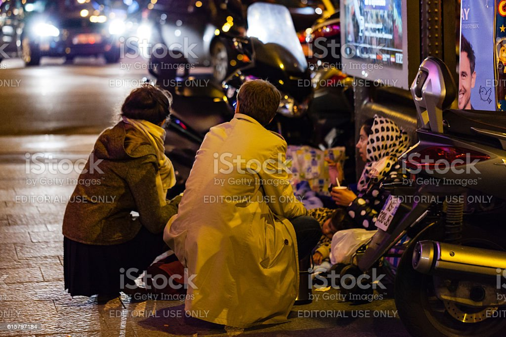 People helping homeless woman and her son stock photo