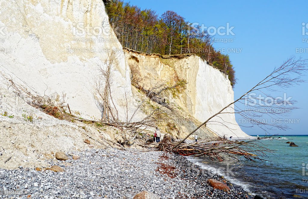 people hiking at chalk rocks of Rugen island stock photo