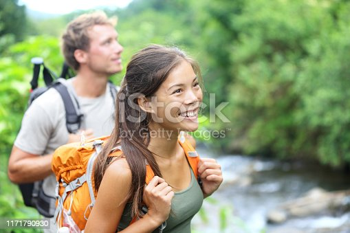 istock People hiking - happy hiker couple on Hawaii 1171790930