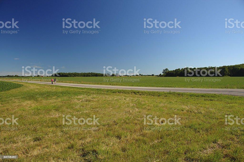 People hiking on an Ontario countryside road near London stock photo