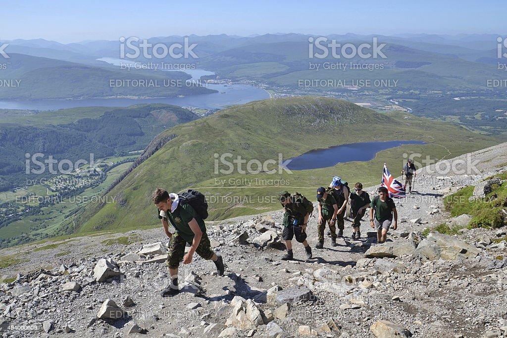 People hiking on path to the Ben Nevis summit stock photo