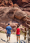 Man and woman hiking Red Rocks near Las Vegas, Nevada