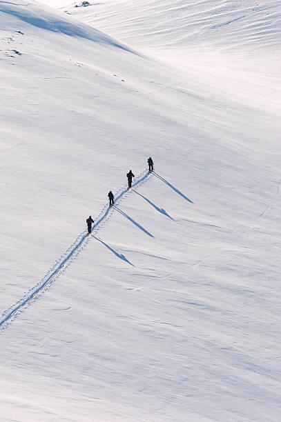 People Hiking through Snow stock photo