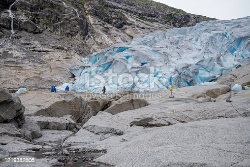 People hiking to blue glacier in the mountains
