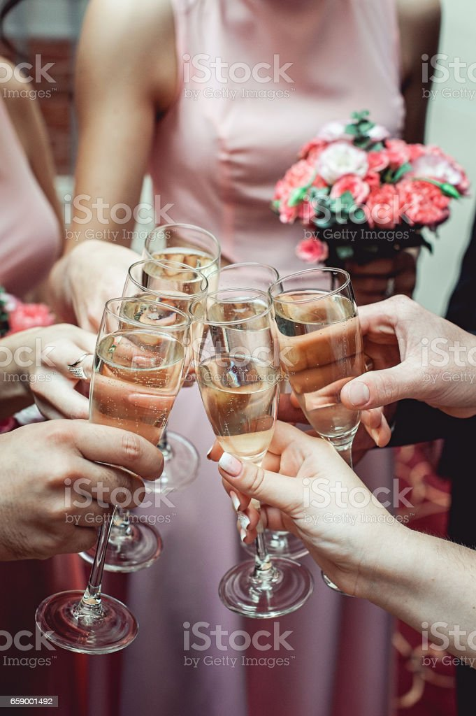 People hold in hands glasses with white wine. wedding party. royalty-free stock photo