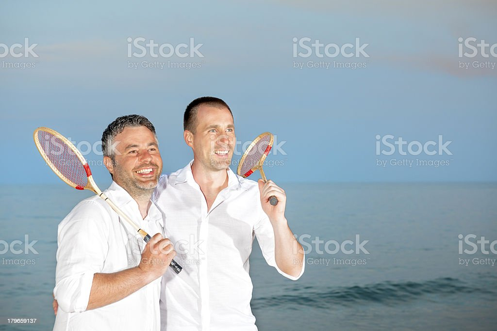people holding badminton rackets royalty-free stock photo