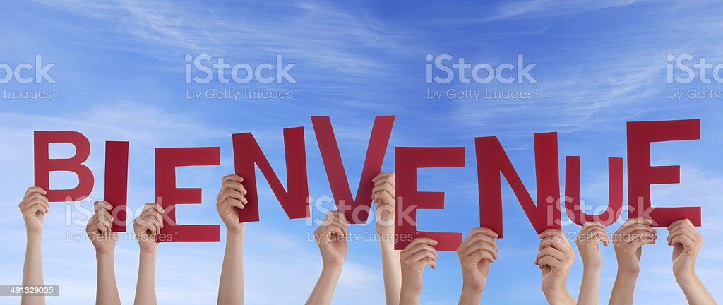 People Holding Bienvenue in the Sky stock photo