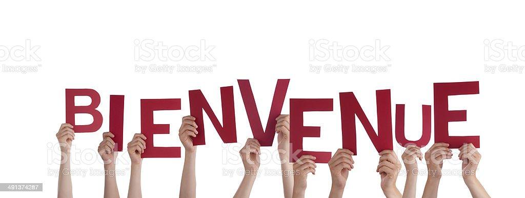 People Holding Bienvenue stock photo