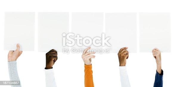 istock People holding blank billboards 187104657