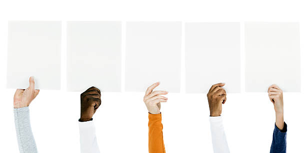 People holding blank billboards stock photo