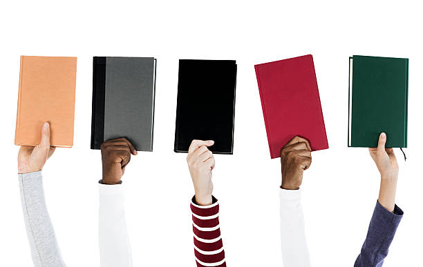 People holding books stock photo