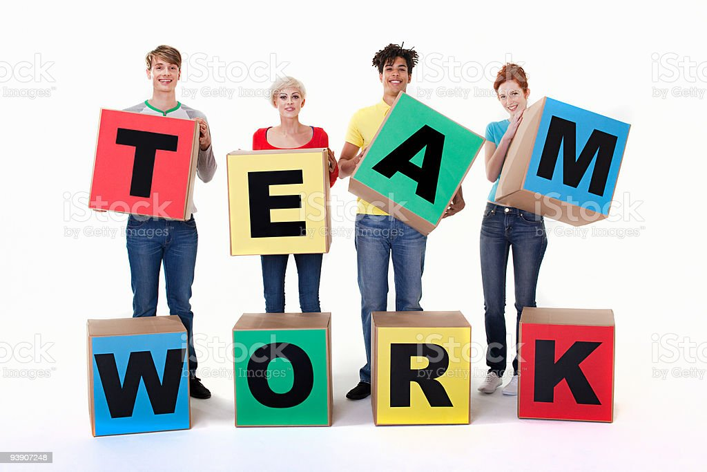 People holding boxes that read team work stock photo