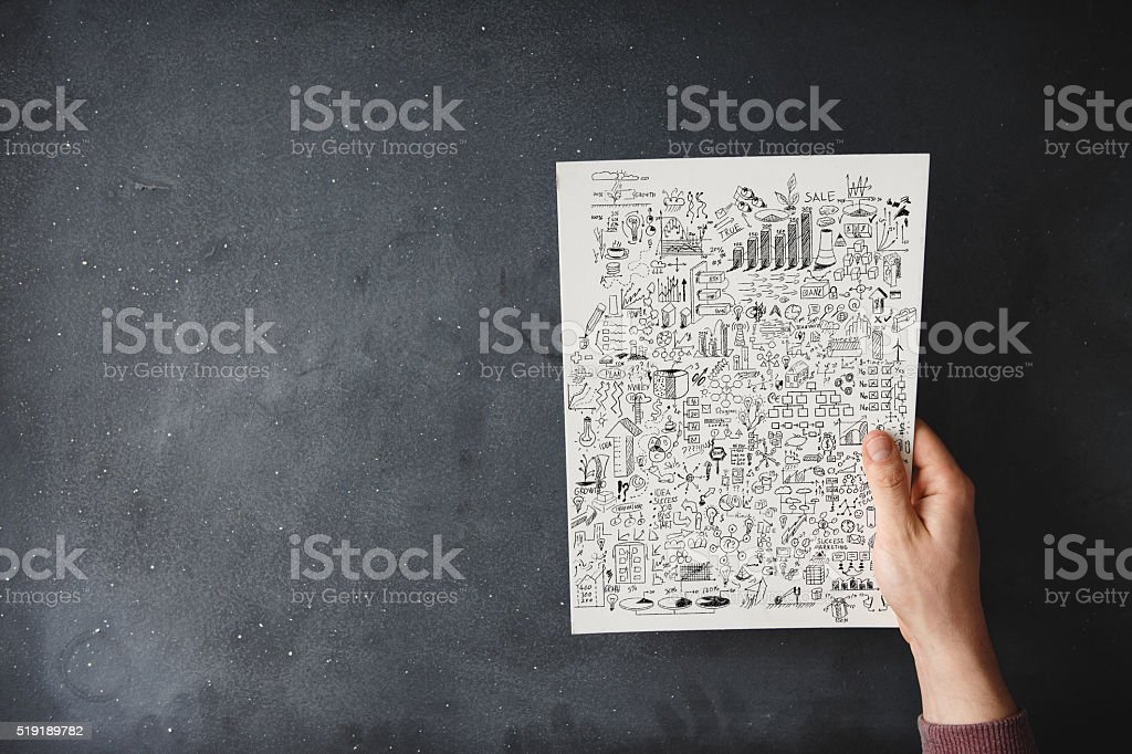 People holding business plan document on black desk stock photo