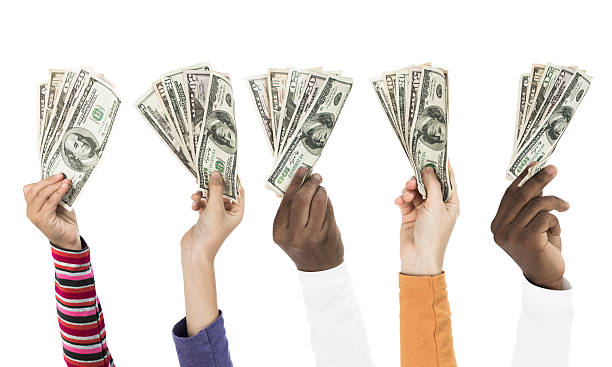 People holding dollars stock photo