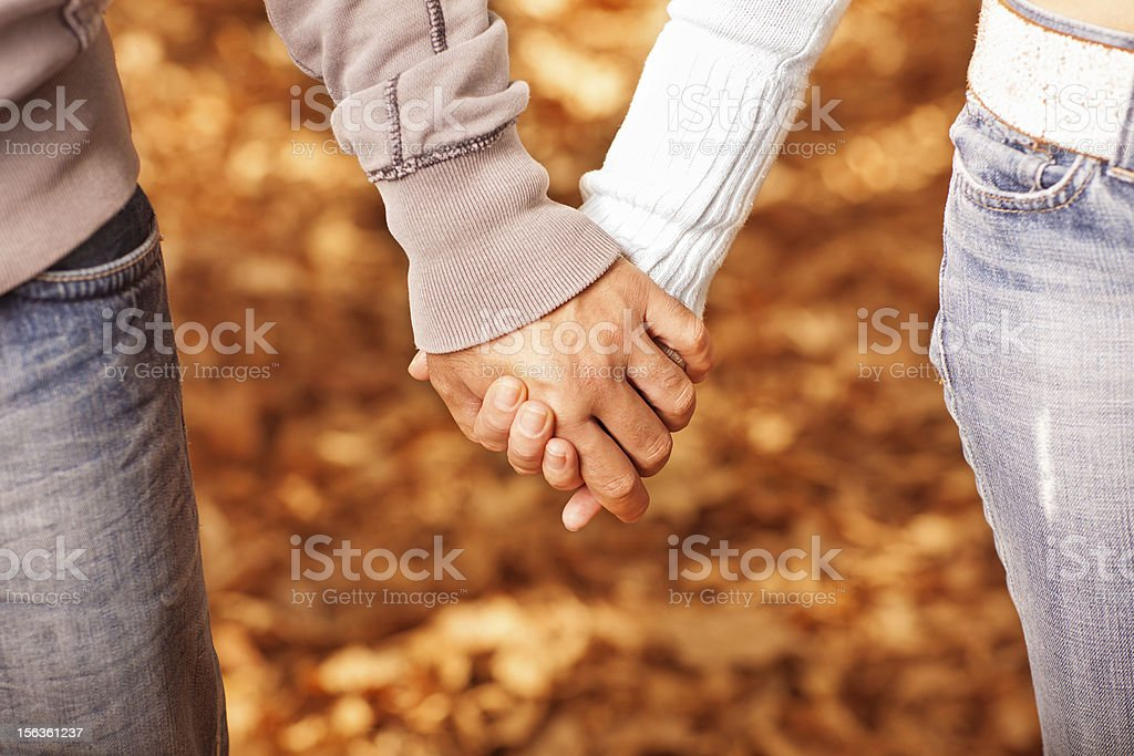 People holding each other by hands - Royalty-free Adult Stock Photo