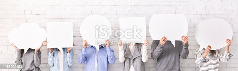 istock People holding empty speech bubbles at their faces 1163502153