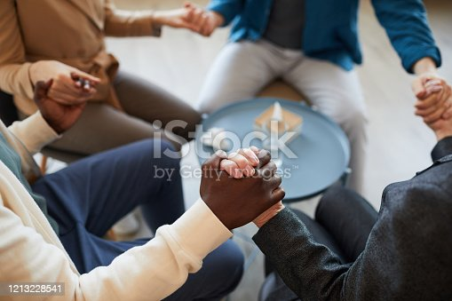 847516586 istock photo People Holding Hands in Support Group Background 1213228541