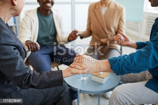 847516586 istock photo People Holding Hands in Support Group Close up 1213228491