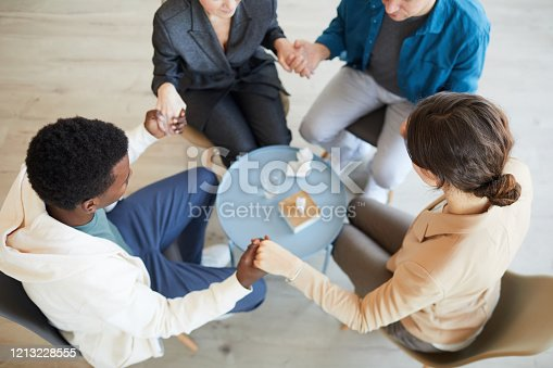 847516586 istock photo People Holding Hands in Support Group Therapy 1213228555