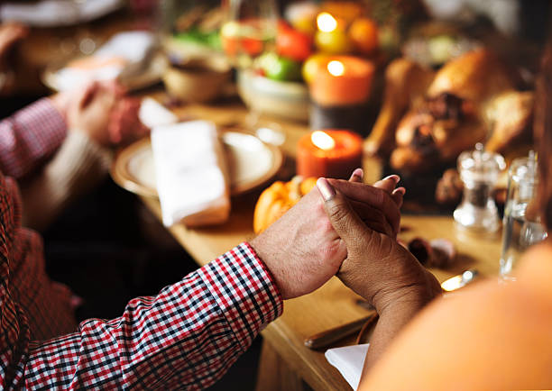 People Holding Hands Praying Thanksgiving Celebration Concept stock photo
