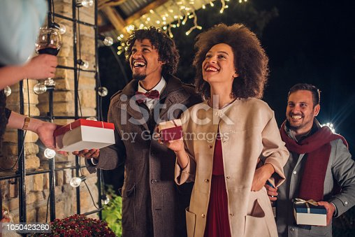 Happy young people holding presents