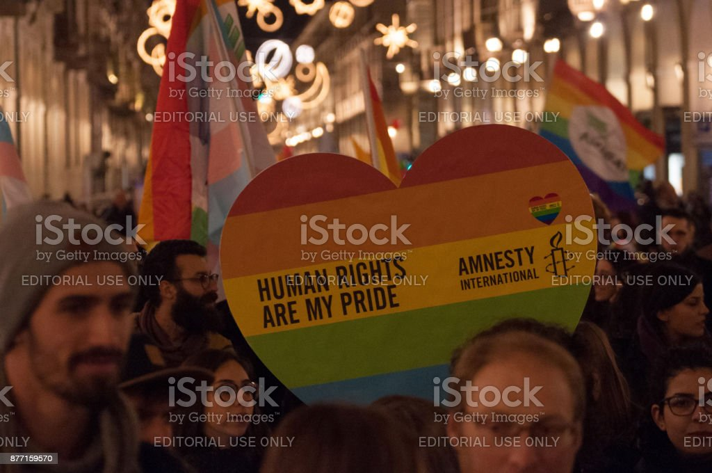 People holding rainbow heart sign at Trans Freedom March stock photo