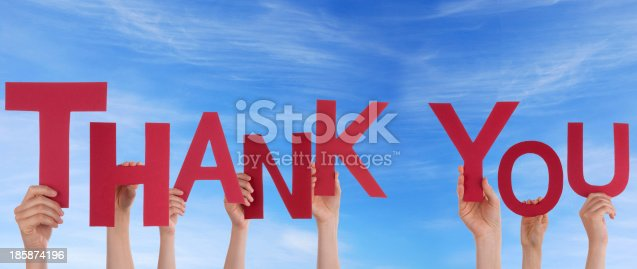 istock People Holding Thank You in the Sky 185874196
