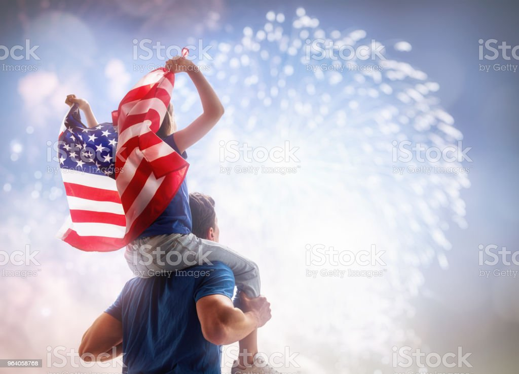 People holding the Flag of the USA. - Royalty-free Adult Stock Photo