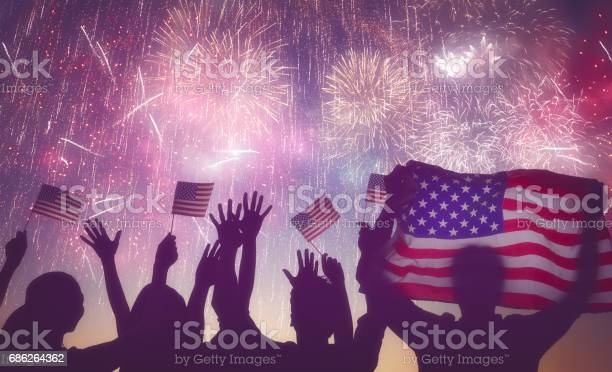 People Holding The Flag Of Usa Stock Photo - Download Image Now