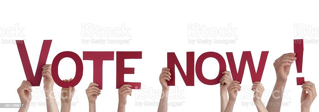 People Holding Vote Now stock photo