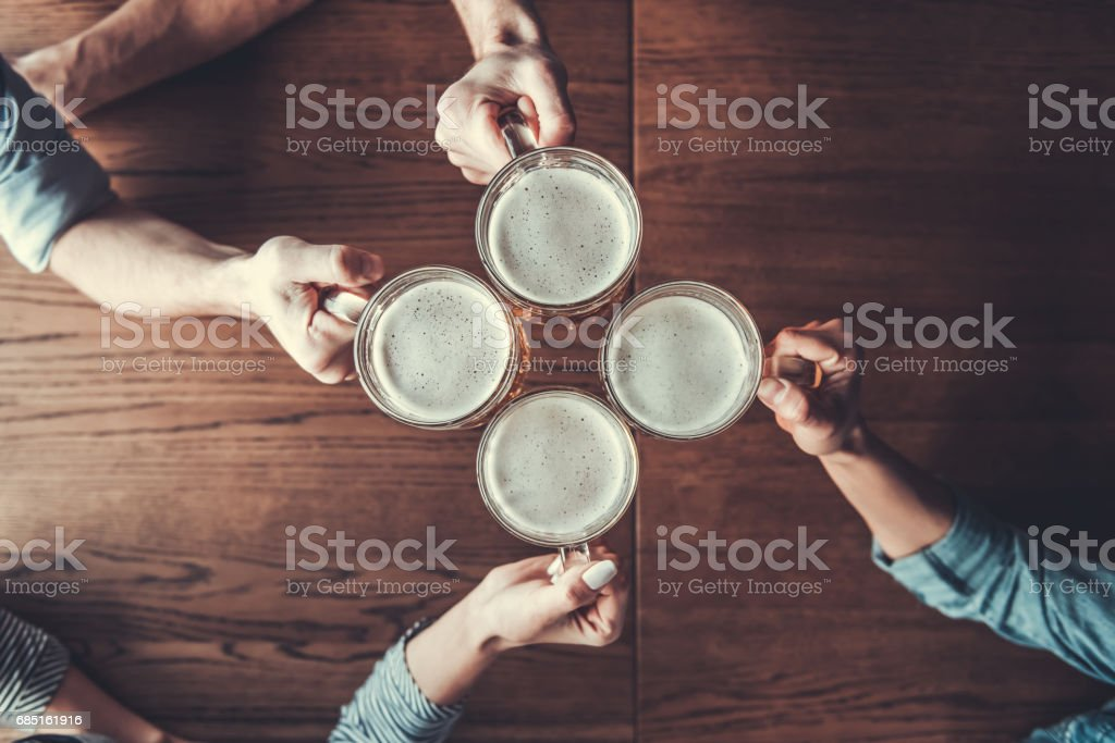 People holds mugs stock photo