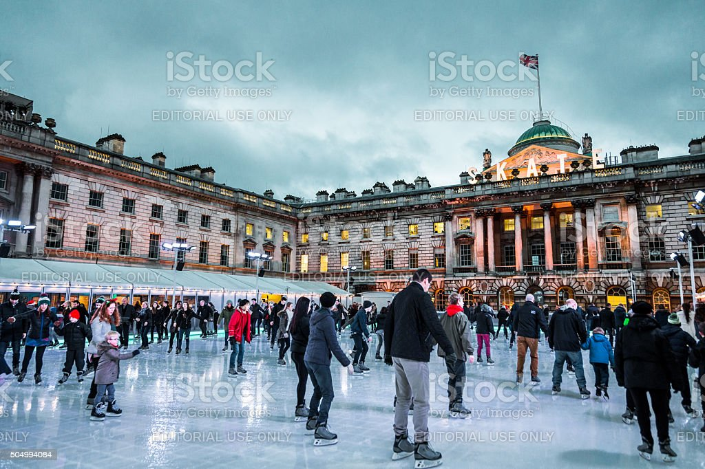 People ice skating at Christmas at Somerset House, London, UK stock photo