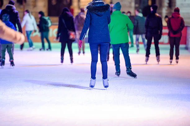 People ice skating at night in Vienna, Austria. Winter. People ice skating at night in historical centre of the city of Vienna, Austria. Winter. ice skating stock pictures, royalty-free photos & images