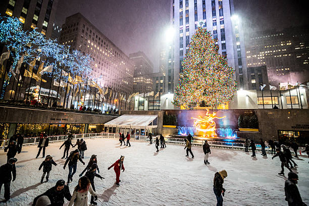 People ice-skating at Rockefeller Center, NYC stock photo