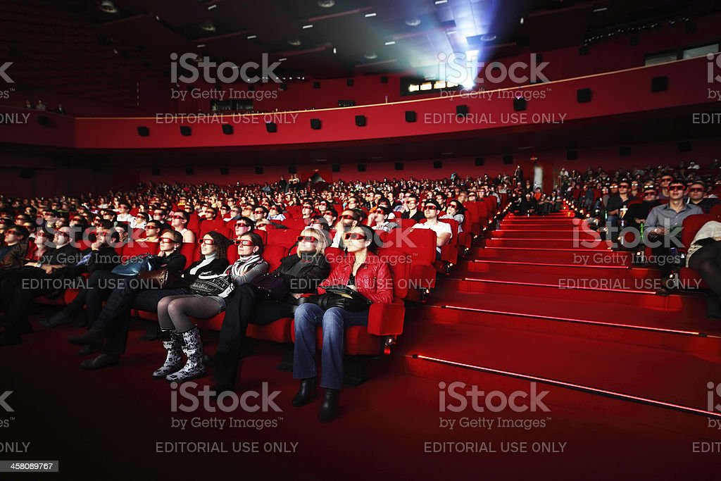 People in 3d-glasses watches film. stock photo