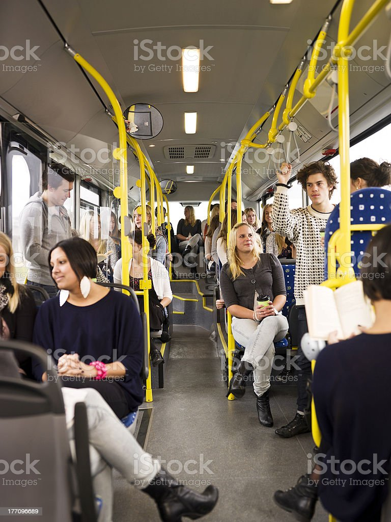 People in a bus stock photo