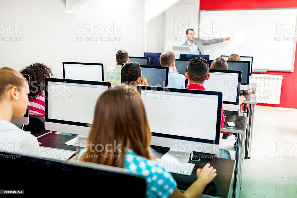 People in a computer seminar. stock photo