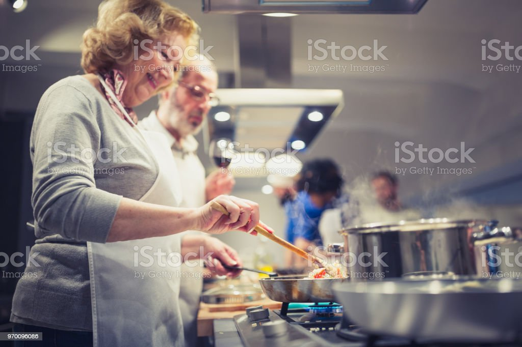 People in a cooking class enjoying their time stock photo