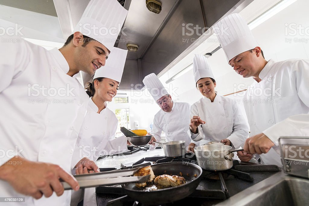 People in a cooking class stock photo