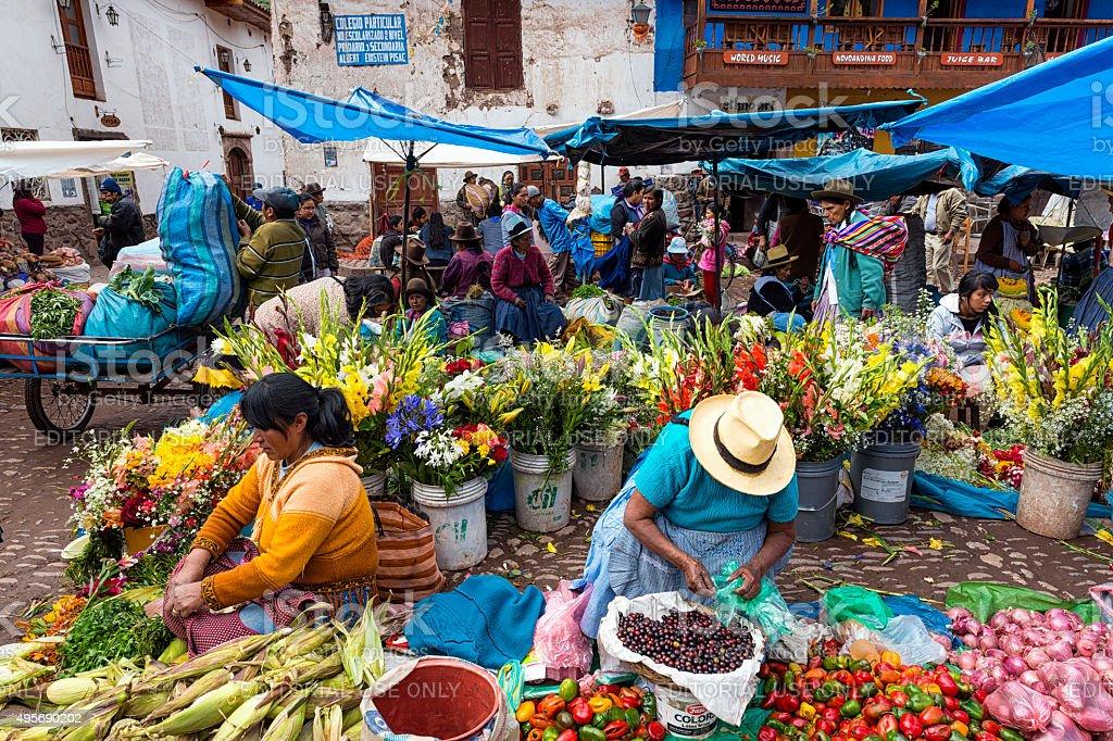 People in a market in Pisac, Peru stock photo