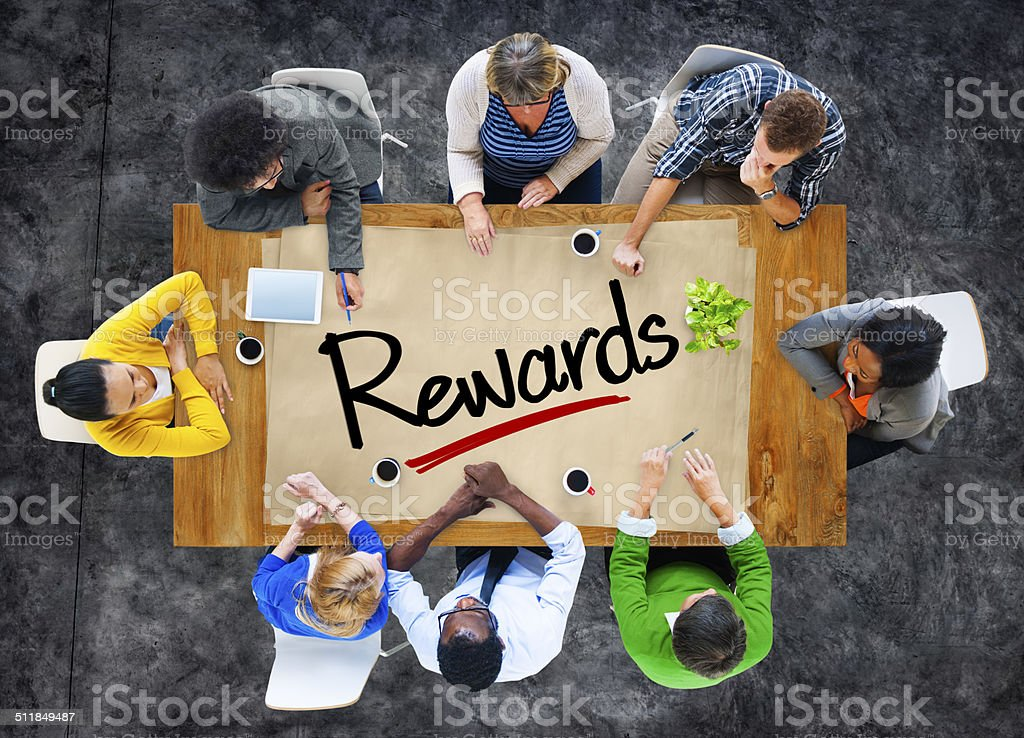 People in a Meeting and Single Word Rewards stock photo