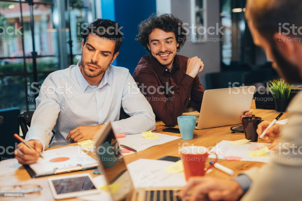 People in a shared office stock photo