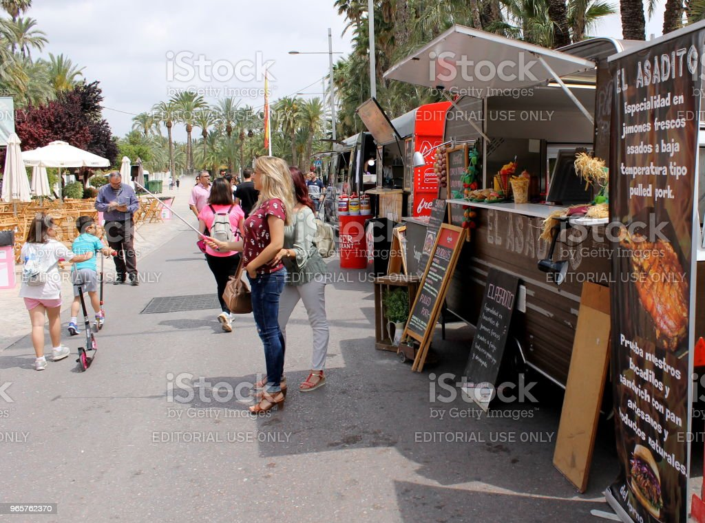 People in a street food truck fair - Royalty-free Adult Stock Photo