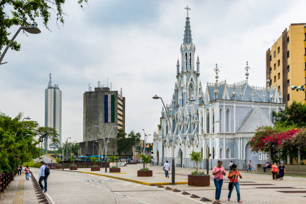 People in a street in front of the La Ermita Church in city of Cali, Colombia stock photo